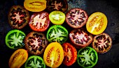 Various halved tomatoes (seen from above)