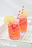 Two glasses of homemade watermelon lemonade on a tray