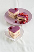Heart-shaped sponge cakes with raspberry cream and redcurrant jelly