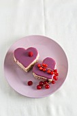 Two heart-shaped sponge cakes with raspberry cream and redcurrant jelly