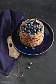 A mini chocolate cake with blueberries