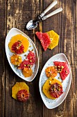 Chia pudding with slices of orange and grapefruit in bowls