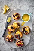 Berry muffins filled with lemon curd