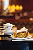 Viennese coffe houses, apple strudel with cream in Café Landtmann, Vienna