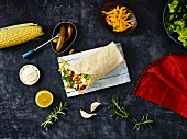 A chicken wrap with ingredients