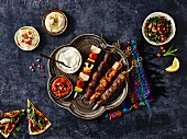 Middle Eastern kebab platter with dips, tabbouleh and unleavened bread
