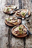 Tarte flambée with sliced apple and courgette