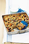 Muesli bars with dried fruit on a baking tray