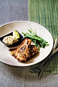 Grilled pork chops with peanut sauce and green beans
