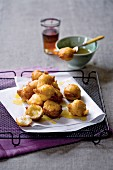 Deep-fried honey and ricotta balls flavoured with orange