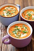 Cream of tomato and lentil soup with herbs