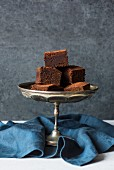 Miso chocolate brownies on a cake stand