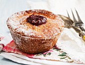 A doughnut muffin with raspberry jam