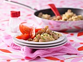 Scrambled eggs with wholemeal pasta and tomato salad