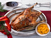 Roast Christmas goose with mashed potatoes and pumpkin