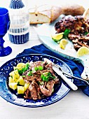 Slow-roasted lamb shoulder with potato salad