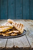 Banana and spelt waffles with icing sugar on a tin tray