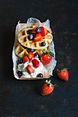 Churro waffles with fresh berries and cream