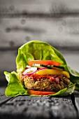 A gluten-free veggie burger in a lettuce leaf