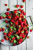 Fresh strawberries on a metal tray