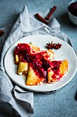 Russian crepes with cottage cheese and plum and star anise compote