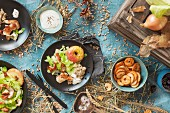Salad with turkey strips and baked apples on an autumnal laid table