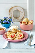 Strawberry dumplings with vanilla sauce