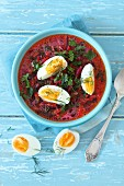 Beetroot soup with tender beetroot leaves, cream and hard-boiled eggs