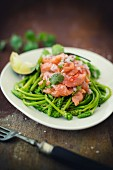 Salmon trout ceviche on wild asparagus