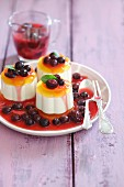 Panna cotta with fruit jelly and berry compote