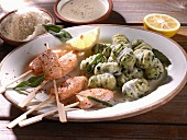 Salmon kebabs with spinach gnocchi, sage and Parmesan cheese