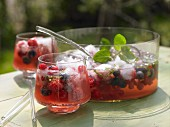 Summer berry punch with champagne and limes