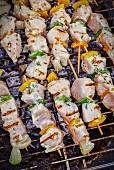 Seabream kebabs on a barbecue