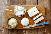 An arrangement of cheese with feta, buffalo mozzarella, cottage cheese and pecorino