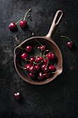 Fresh cherries in an old pan