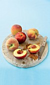 Peaches on a wooden chopping board
