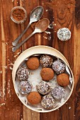 Date energy balls rolled in cocoa powder and desiccated coconut