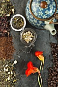 An arrangement featuring herbal tea, a teapot and coffee beans