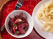 Red onion and bacon sauce with tagliatelle