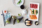 Various types of homemade sushi and sashimi for a party