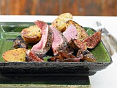 Wild boar with juniper figs and roast potatoes