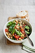 Chickpea salad with peppers and baby spinach