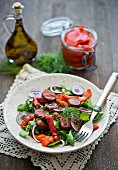 Salad with chorizo, peppers and red onions