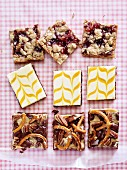 Cheesecake slices and various oat bars
