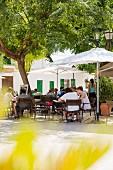 Guests at a street café in Santa Gertrudis on Ibiza, Spain