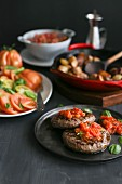 Burgers with tomato salsa, beef tomatoes and fried potatoes