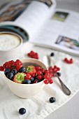 Summer berries in a white bowl for breakfast