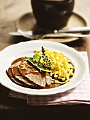 Sauerbraten (marinated pot roast) with home-made Spätzle (soft egg noodles) from Munich