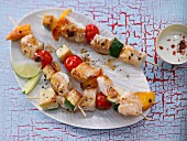 Grilled fish and vegetable kebabs with a lime dip
