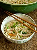Oriental noodles with vegetables and chopsticks